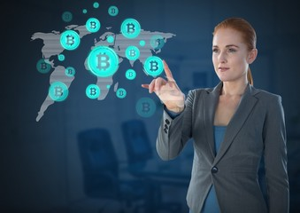 Businesswoman touching bitcoin graphic icons on world map