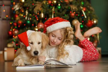 Girl with golden retriever, christmas