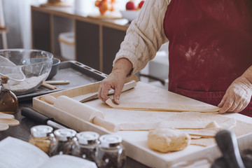 Person cutting dough into strips