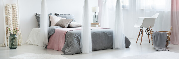 Bedroom with canopy above bed