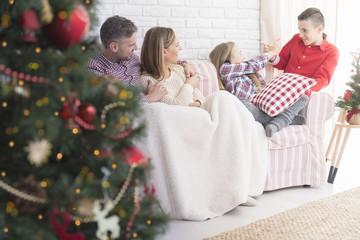 Happy family and christmas tree