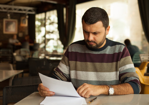 Worried man reading a document