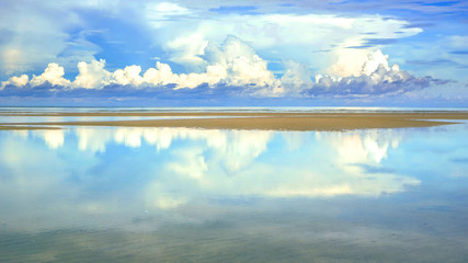 Refletion of blue sky on water surface at beatiful beach