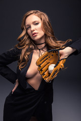 sexy woman in black jacket with baseball mitt and ball