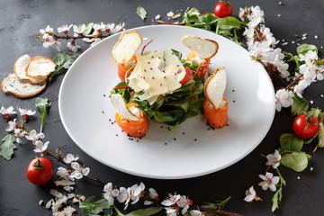 Restaurant dish on white plate on black background