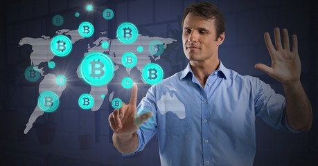 Businessman touching bitcoin graphic icons on world map