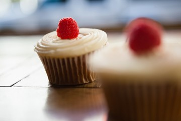 Close up of raspberry cupcakes on table