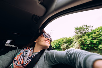 Woman enjoy with view from car window in traveling by auto