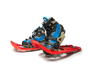 Mountaineering Boots and snowshoes on the white background