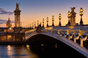 Pont Alexandre III Bridge and illuminated lamp posts at sunset with view of the Invalides. 7th Arrondissement, Paris, France Fototapete