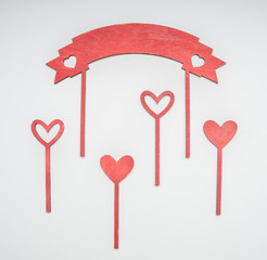 composition on the day of the holy valentine, hearts on sticks, on a white background, top view
