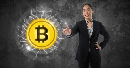Businesswoman touching bitcoin graphic icon