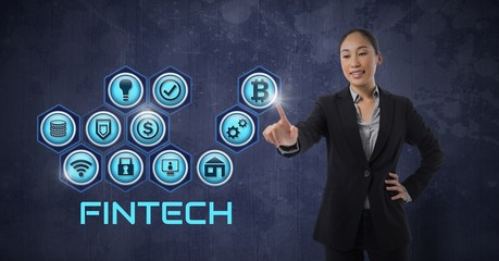 Businesswoman touching Fintech with various business icons