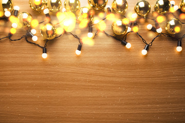 party light with gold decor ball in christmas concept on wood ground