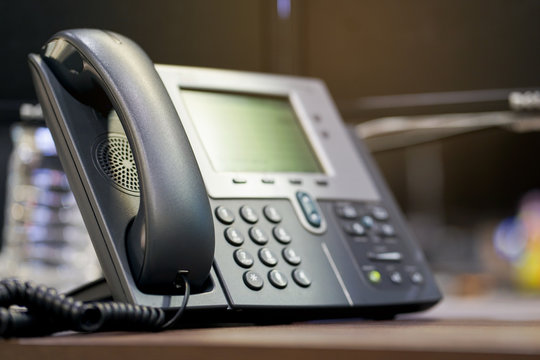close up soft focus on telephone devices at office desk ,telecommunication technology concept