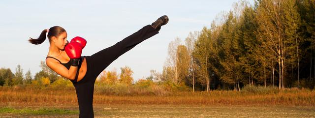 Female kickboxer exercising outdoor