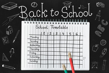 Schedule at school for the whole week. Hand-drawn table with a lesson plan for the whole week. Back to school and a new schedule. Drawings about school subjects.