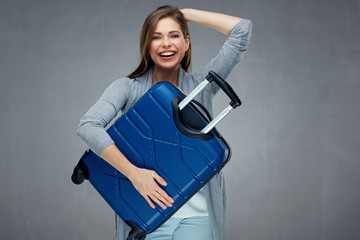 Happy woman holding dark blue case in front of her.