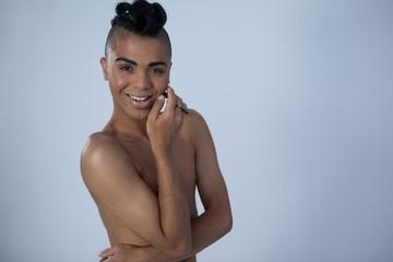 Sensuous transgender woman smiling