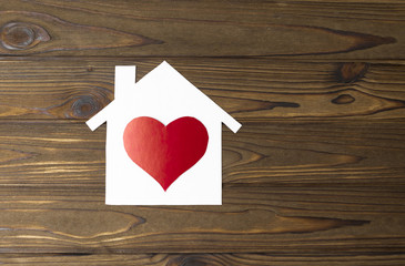 house made of paper, heart shape on a wooden background