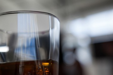 Close up of half filled whiskey glass