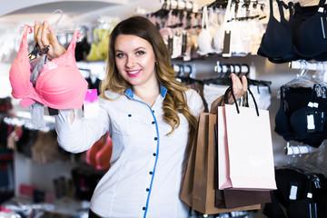 Smiling female shopper is enjoying her purchases