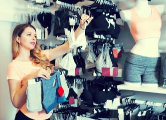Girl is choosing sports underwear