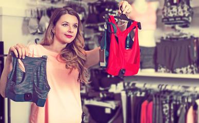 Female customer deciding on sports underwear