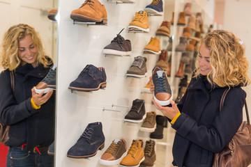 beautiful woman in a shopping, trying shoes