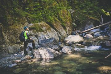 Man canyoneering in Deneau Creek, Hope, British Columbia, Canada