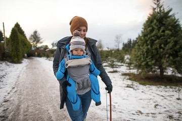 Mother with baby at Christmas tree farm, Langley, British Columbia, Canada