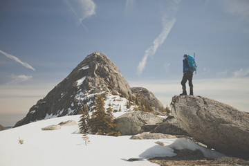 Hiker looking at view of Needle Peak in winter, British Columbia, Canada