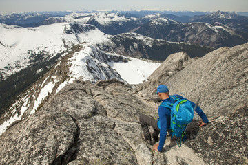 Backpacker descending Needle Peak, Hope, British Columbia, Canada