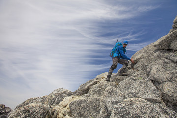 Backpacker descending Needle Peak, Hope, British Columbia, Canada