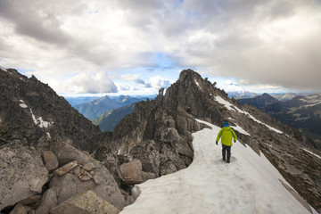Mountain climber approaching south summit of Mount Rexford, Chilliwack, British Columbia, Canada