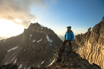 Mountain climber looking at view at sunset, Chilliwack, British Columbia, Canada