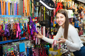 Woman selecting collars and leads