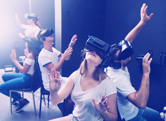 Young people try virtual realityin the goggles