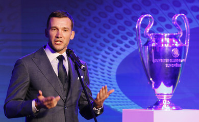 Ukraine's national soccer team coach Andriy Shevchenko speaks next to the UEFA Champions League trophy during the unveiling ceremony of the logo of the 2018 Champions League final soccer match in Kiev