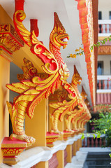 Decor in the form of a gold fiery bird (rooster) in decoration of the Cambodian monastery.