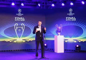 Kiev Mayor Vitali Klitschko speaks next to the UEFA Champions League trophy during the unveiling ceremony of the logo of the 2018 Champions League final soccer match in Kiev