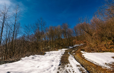 mountain dirt road in winter. beautiful sunny day