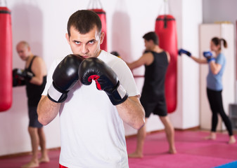 calm sportsman in the boxing hall practicing boxing punches