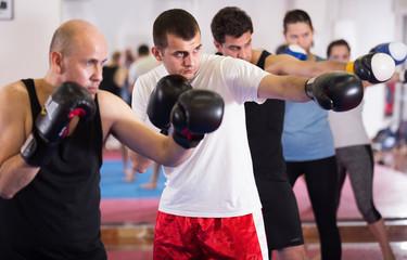 Portrait of men training at sparring together