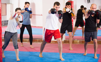 Friendly sportsmen practicing boxing punches