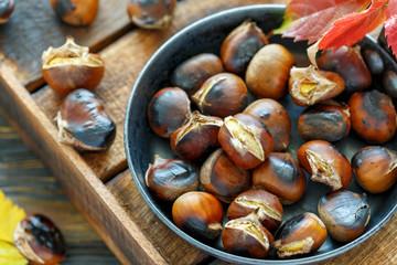 Roast chestnuts in a pan closeup.