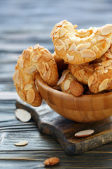 Almond crescent cookies in a wooden bowl.