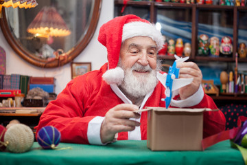 Santa Claus packing toys for children
