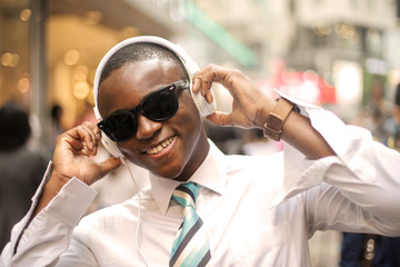 Young businessman with sunglasses and headphones