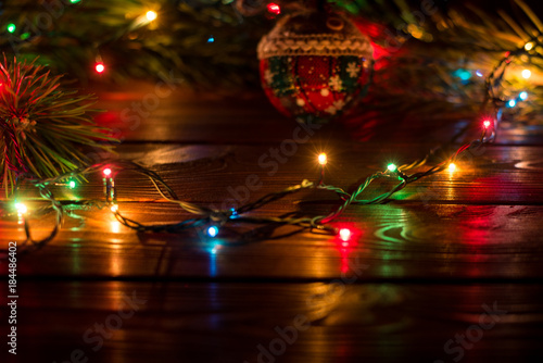 wreath and garlands of colored light bulbschristmas background with lights and free text space